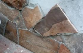 выполнение работ по отделке цоколя камнем