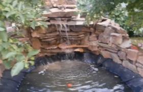 Садовый фонтан-стена