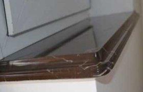 фотография подоконника из гранита коричневого цвета